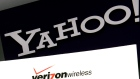 the Yahoo and Verizon logos on a laptop