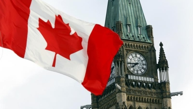 The Canadian flag flies on Parliament Hill in Ottawa article image