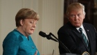 President Donald Trump looks to German Chancellor Angela Merkel during a joint news conference