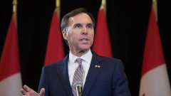 Bill Morneau speaks during a press conference at the media lock-up before tabling the federal budget
