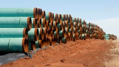 miles of pipe ready to become part of the Keystone Pipeline are stacked in a field near Ripley, Okla