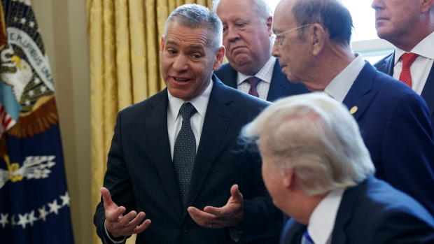 TransCanada CEO Russell K. Girling speaks to President Donald Trump in the Oval Office