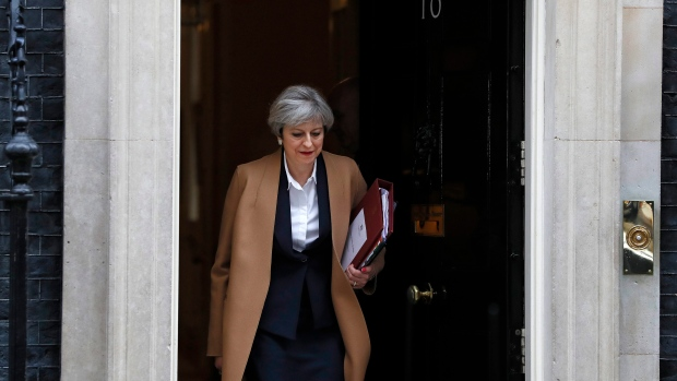 Theresa May leaves 10 Downing Street on her way to the House of Commons in London, March 29, 2017.