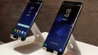 New Samsung Galaxy S8, left, and Galaxy S8 Plus mobile phones are displayed in New York.