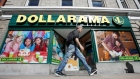 A pedestrian walks past a Dollarama store in Ottawa, Ontario, Canada, September 1, 2016.