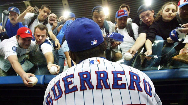 Montreal baseball fans clamour for Vladimir Guerrero's autograph at a 2014 Blue Jays exhibition game
