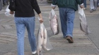 People carry salmon after purchasing it from fishers on the docks in Steveston, B.C.