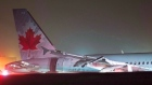 Air Canada flight 624 rests off the runway after landing at Stanfield International Airport