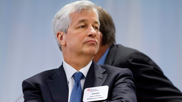 JPMorgan Chase Chairman and CEO Jamie Dimon listens as President Barack Obama speaks in 2014