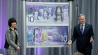 Governor of the Bank of Canada Stephen Poloz and Ginette Petitpas Taylor unveil a new $10 note