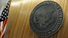 The seal of the U.S. Securities and Exchange Commission hangs on the wall at SEC headquarters.