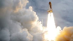 The space shuttle Atlantis lifts off from the Kennedy Space Center Friday, July 8, 2011