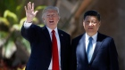 President Donald Trump and Chinese President Xi Jinping pause for photographs at Mar-a-Lago