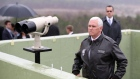 Mike Pence looks at the North side from Observation Post Ouellette in the Demilitarized Zone