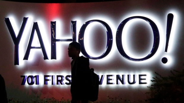 A person walks in front of a Yahoo sign at the company's headquarters in Sunnyvale, California