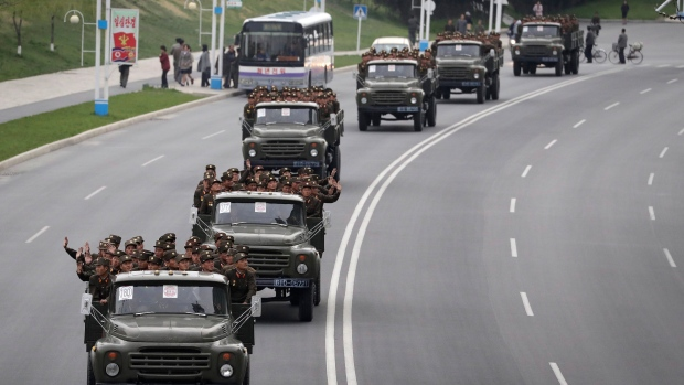 North Korean soldiers sit at the back of trucks in Pyongyang, North Korea
