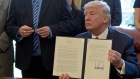 Donald Trump displays his executive order on foreign steel