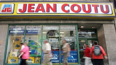 Pedestrians walk past a Jean Coutu pharmacy in Montreal