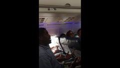Kima Hamilton in a video of him being asked to leave a Delta flight