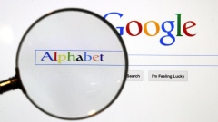 A Google search page is seen through a magnifying glass in this photo illustration