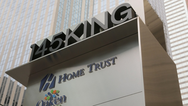 A sign shows the logos of Home Capital Group's subsidiaries Home Trust and Oaken Financial.