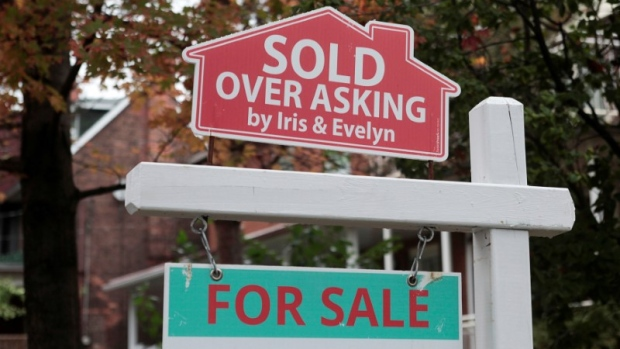 """Sold over asking"" sign on display in Toronto, Ontario"