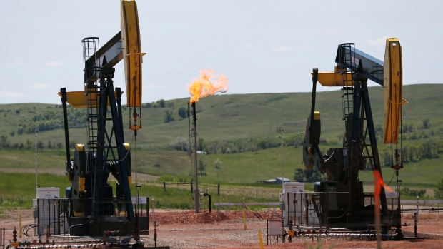 methane In this June 12, 2014 file photo, oil pumps and natural gas burn off in Watford City, N.D.