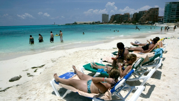 Tourists on a beach in Cancun, Mexico