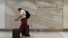 A man arrives at the British Airways check-in desk at Gatwick Airport in southern England, Britain,