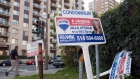 A real estate signs stand in front of a condo September 27, 2011 in Montreal. Montreal real estate