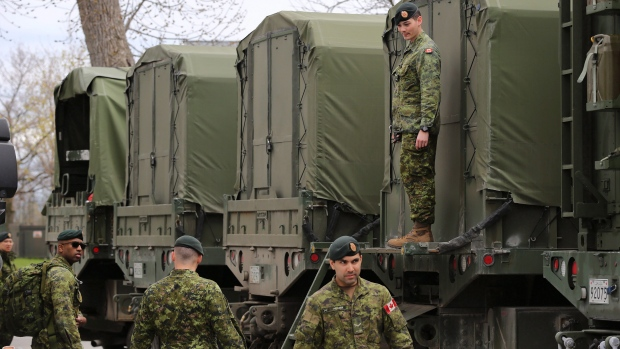 Reservists help pack military vehicles with boats and fuel at CFB Kingston Kingston, Ont.