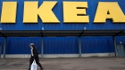 A shopper walks past a sign outside an IKEA store in Wembley, north London, Britain