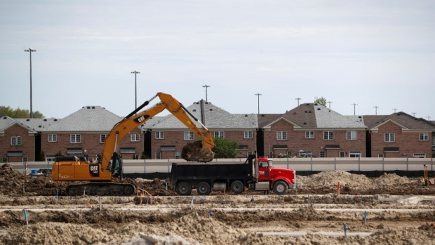 Canadian housing starts slip in hot markets of toronto for Building a house in ontario
