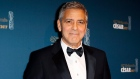 George Clooney poses with the Honorary Cesar award in 2017