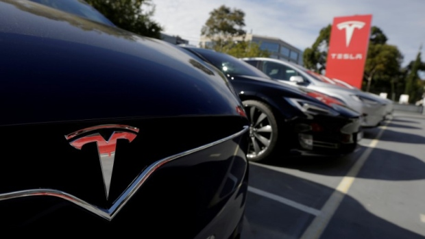 A Tesla Model X is photographed alongside a Model S at a Tesla electric car dealership in Sydney