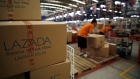 Employees at online retailer Lazada fill orders at the company's warehouse in Jakarta, Indonesia