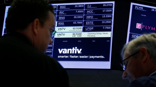 Traders wait for news at the post where U.S. credit card technology firm Vantiv Inc is traded