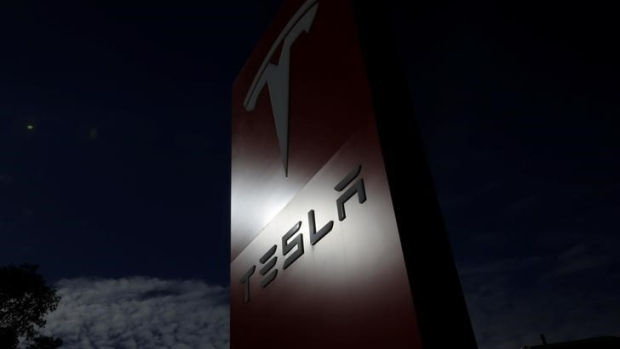 The Tesla corporate logo is pictured at a Tesla electric car dealership in Sydney, Australia