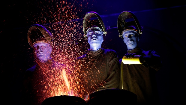Cirque du Soliel merges with Blue Man Group, getting greasepaint everywhere