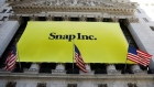 The front of the New York Stock Exchange with a Snap Inc. logo