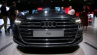 Attendees view the Audi A8 at the Audi Summit in Barcelona, Spain July 11, 2017