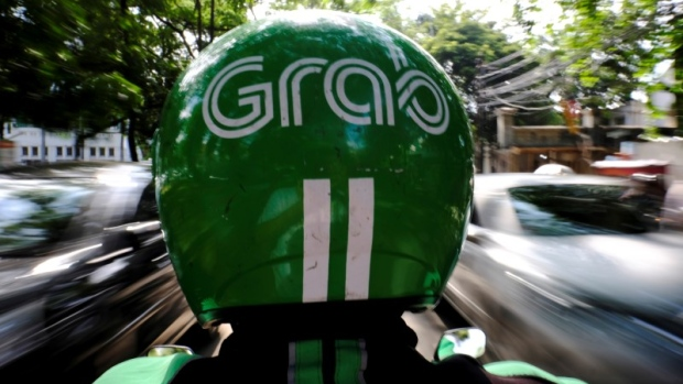A Grab motor driver is seen in a street in Jakarta, Indonesia