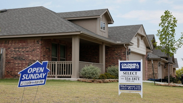 U.S. real estate signs at a new home community in Edmond, Okla.
