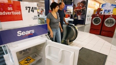 Customers enter the appliance department at a Sears store in Niles, Ill.