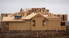 Builders work on a new home in the Beacon Hills area of Fort McMurray