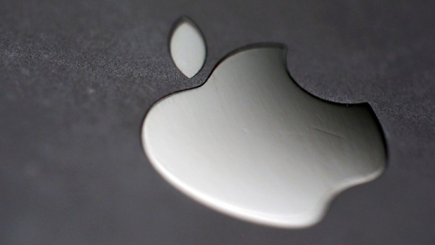 The Apple logo is pictured on an iPhone in an illustration photo taken in Bordeaux, France
