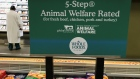 A sign explains animal treatment standards in the meat department at a Whole Foods Market