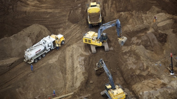 Heavy earth moving equipment work clearing an area at the new Suncor Fort Hills tar sands