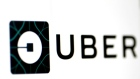 The Uber logo is seen on a screen in Singapore August 4, 2017.