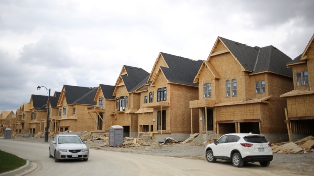 Canadian building permits rise in june single family home for Building a house in ontario